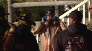 Authorities donned gas masks to investigate the alleged meth lab. (WBZ-TV)